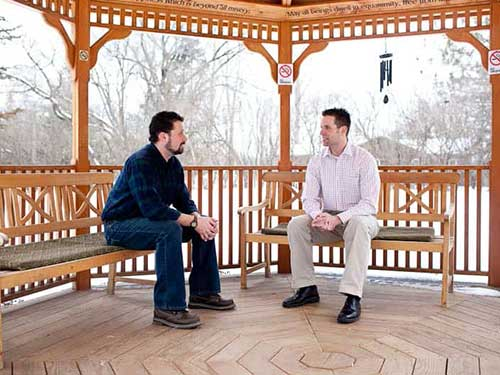 Adults Talking in Gazebo